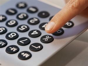 Finger Pressing Button on Calculator