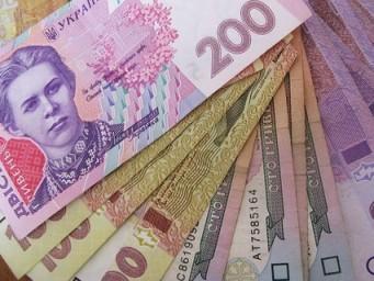 Украинцы открывают депозиты в национальной валюте