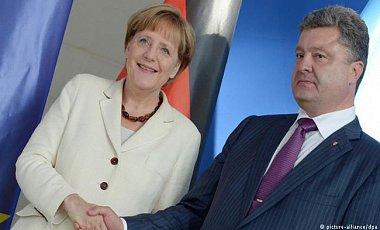 Меркель встретилась с Порошенко и пообещала помощь Германии