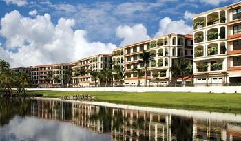 Paulson увеличил размеры своей недвижимости в Пуэрто-Рико, приобретя AIG Building