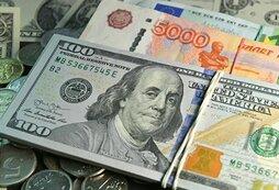 Рубль укрепился к евро, но слегка снизился к доллару на старте торгов